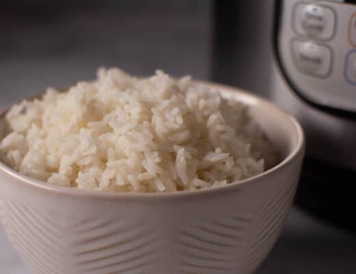 bowl of white rice in front on instant pot